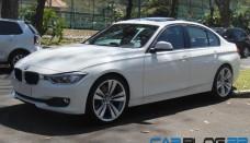 BMW 328i Observando se a nova de lateral e traseira Wallpapers Download