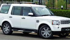 Land Rover Discovery white color side view Wallpaper Backgrounds