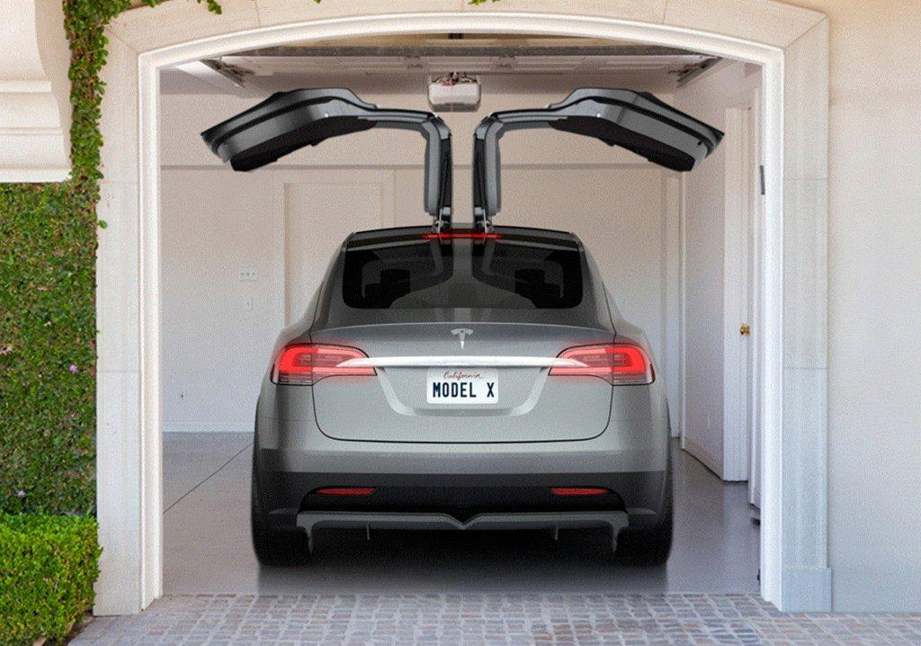 Tesla X in garage is its top hinged doors that open up not out tesla calls Wallpaper Gallery Free